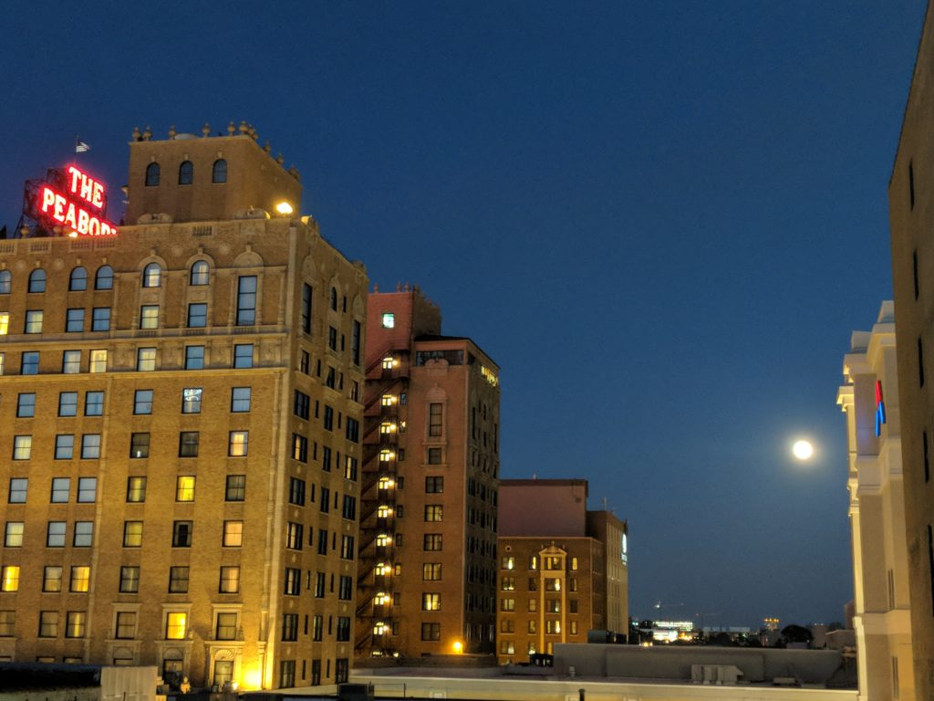 Peabody Hotel with full moon rising to the right